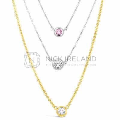 DBP6 / 18ct gold white and yellow gold diamond pendants